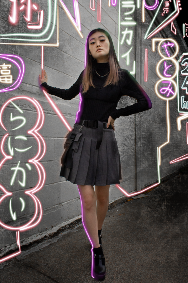 Model Rae Ma poses in a techwear inspired outfit.